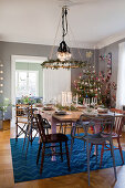 Festively set table and decorated Christmas tree in dining room