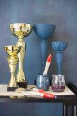 Painting golden goblets blue