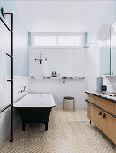 Freestanding bathtub, shower and vanity in the bathroom