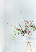 Delicate flower arrangement with astrantia and eucalyptus