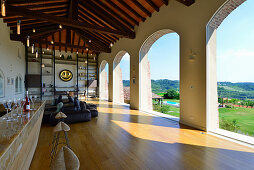 Elegant loggia with arched openings in renovated farmhouse