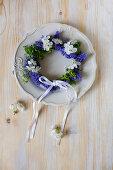 Spring wreath of grape hyacinths on plate