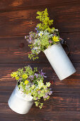 Bunches of wildflowers in metal jugs