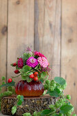 Late summer bouquet with rose hips surrounded by hop vines