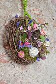 Wreath of maidenhair vine tendrils and spring flowers