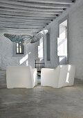 Two white plastic armchairs in traditional Greek house