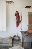Open shower area and dining table in rustic interior
