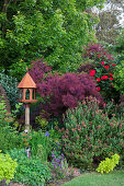 Bird feeder in a landscaped garden