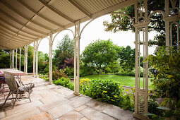 View from the veranda with natural stone floor to the garden