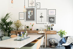 White dining table, shell chairs and rustic workbench in dining room