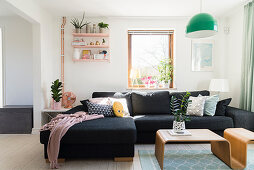 Charcoal sofa and designer table in living room