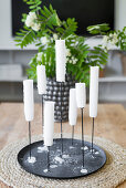 White candles in candle holder