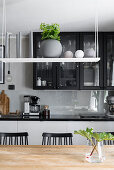 Shelf suspended above wooden table in kitchen
