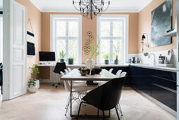 White classic chairs, workspace and dining area with white classic chairs in bright kitchen-dining room