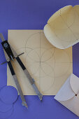 Template for origami envelope drawn on paper with compasses