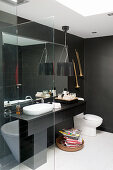 Washstand and toilet in black-and-white bathroom