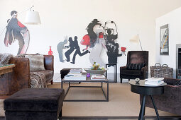 Coffee table, vintage leather sofa, brown armchair and sculptures on walls in living room