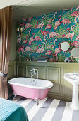 Flamingo-patterned wallpaper and wainscoting in bathroom