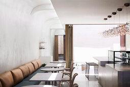 Minimalist restaurant in white and beige