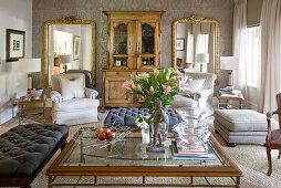 Large mirrors and antique cabinet in classic living room