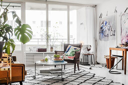 Mixture of furniture and glass wall in artistic living room