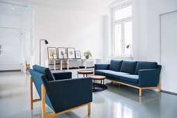 Blue sofa set in white living room in period apartment