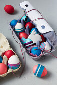 Decorated Easter eggs and Easter bunny in egg boxes