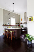 Modern open kitchen without wall units with dark floors