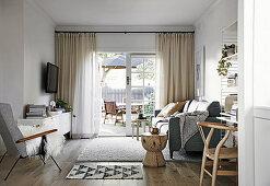 Living room in natural tones with an open patio door
