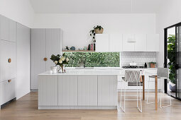 Modern country kitchen in light gray with a horizontal window
