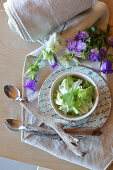 Handmade spoons with driftwood handles on summer place setting