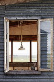 Corrugated iron facade with vintage window (detail)