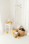 Pale, modern, autumn arrangement of pumpkins, ladder on wall, dreamcatcher and baskets