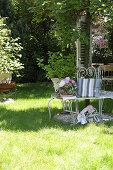 DIY cushion cover made fabric strips on garden bench around tree trunk