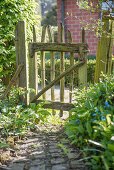 Rural garden gate made of chestnut wood
