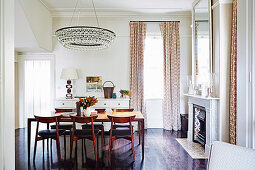 Elegant dining area with a long table and chandelier