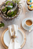 Handmade pussy willow Easter nest, place setting and cup of coffee