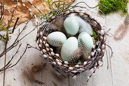 Easter eggs in handmade pussy willow Easter nest