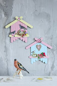 Birdhouse decorations made from painted lolly sticks and scrapbook pictures