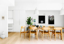 Dining area in a white, open living room
