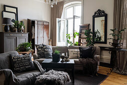 Grey, vintage-style furniture in living room of period building