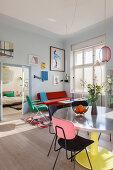 Colourful retro furniture in sunny interior of period building