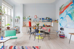 Colourful retro furniture in open-plan kitchen-dining room of period building