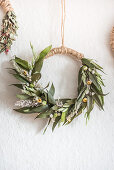 Handcrafted wreath made from leaves, flowers and grasses