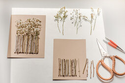 Handcrafting a garden fence of tiny twigs and dried flowers