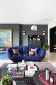 Deep blue, curved sofa in designer living room