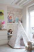Wigwam on felt ball rug in bright nursery