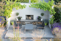 Outdoor furniture around fireplace on terrace