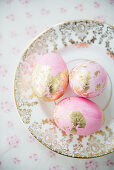 Pink eggs with gold leaf on vintage-style plate