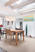 Beams and open ceiling in bright dining room